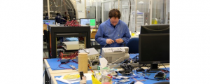 (Image: Anthony Reinhart, Communitech). An employee at the UTIAS Space Flight Laboratory in Toronto assembles a satellite. UTIAS is working with Communitech to send two satellites into space next year.