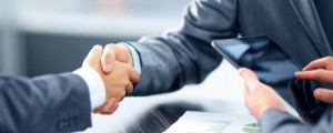 Image of businesspeople shaking hands
