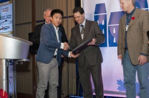 Unhaggle.com founder and CEO Andrew Tai accepts $50,000 in cash and services, first prize in the TiECon Canada pitch fest late last week.