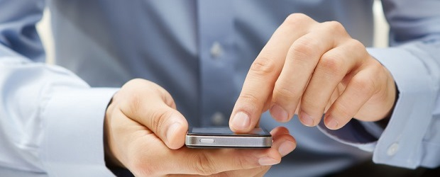 Image of person pushing on phone