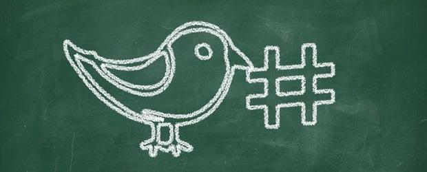 Bird holding a hashtag.