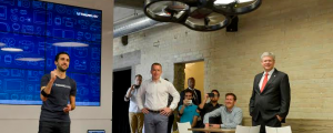 Scott Greenberg, Head of Developer Relations at Thalmic Labs, and Stephen Lake, CEO and co-founder of Thalmic Labs, showcase the Myo armband flying a Parrot drone to Prime Minister Stephen Harper. (left to right)