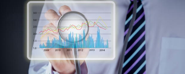 Doctor holds stethoscope to healthcare data graph.