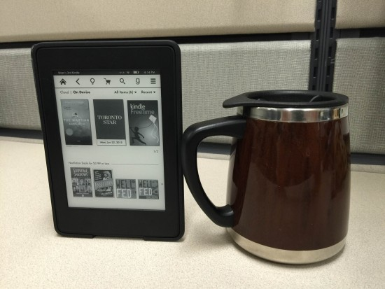 My morning ritual: coffee in one hand, e-reader in the other.
