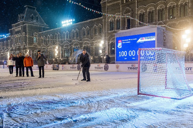 Vladislav Tretiak, one of the greatest Russian goalies of all time, tries to score at the outdoor hockey rink in Red Square as part of a Tissot promotion for their score clock technology.