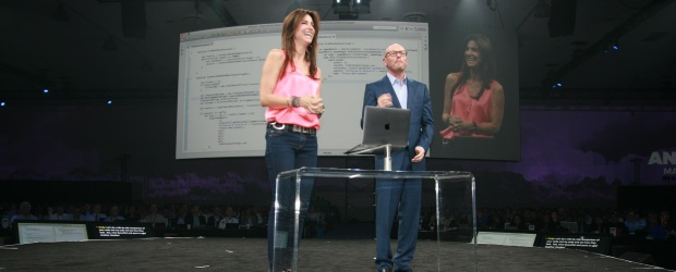 NetSuite founder, CTO, and chair Evan Goldberg receives assistance from his wife, Cindy, while demonstrating the company's updated SuiteScript programming language.