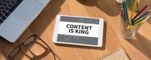 CONTENT IS KING concept on tablet on screen, table and coffee Business