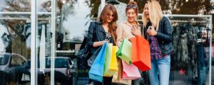 Girls with shopping bags are satisfied with the purchase