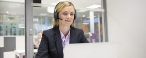 Female headset computerdesk office skype
