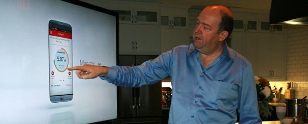 Guy Laurence demonstrates the company's real-time data control service for reporters on Oct. 6. (Photo: Eric Emin Wood)