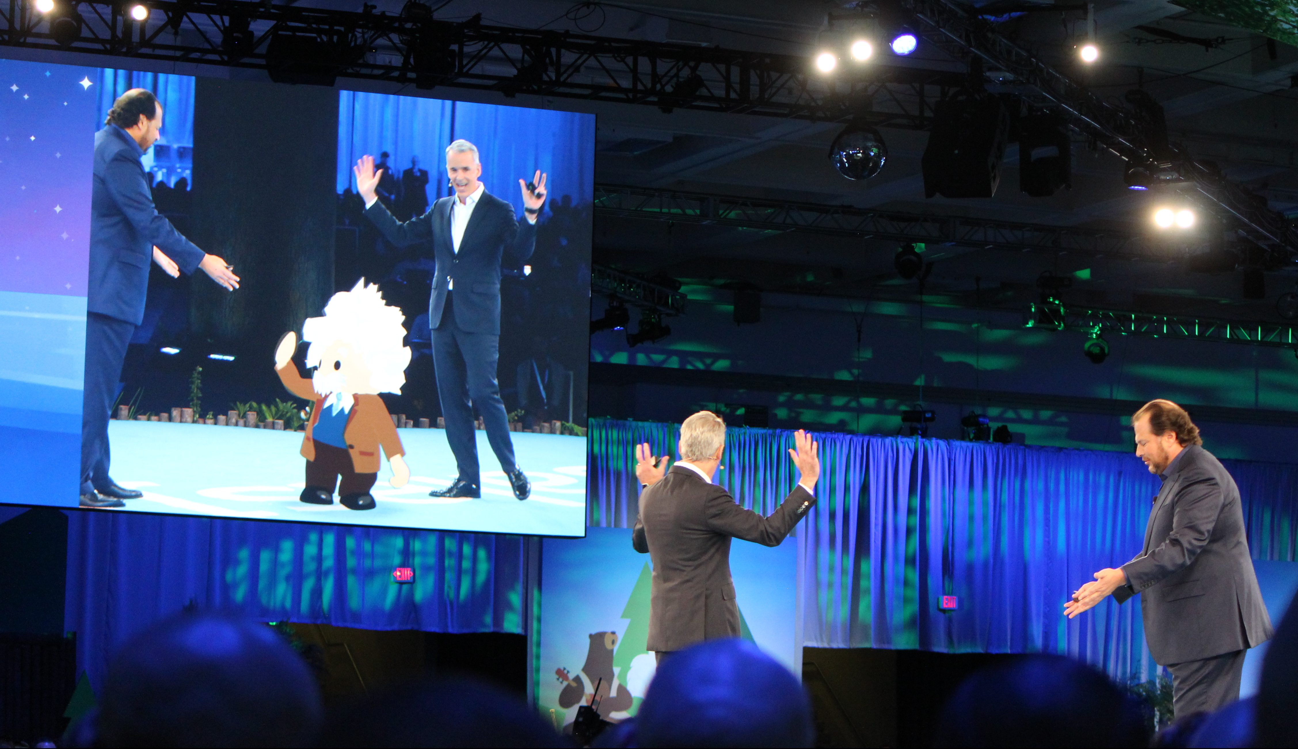 Salesforce co-founders Marc Benioff and Parker Harris interact with an AR Einstein on stage at Dreamforce.