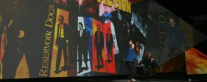 Filmmaker Quentin Tarantino greets the audience during the Adobe Max conference on Nov. 3.